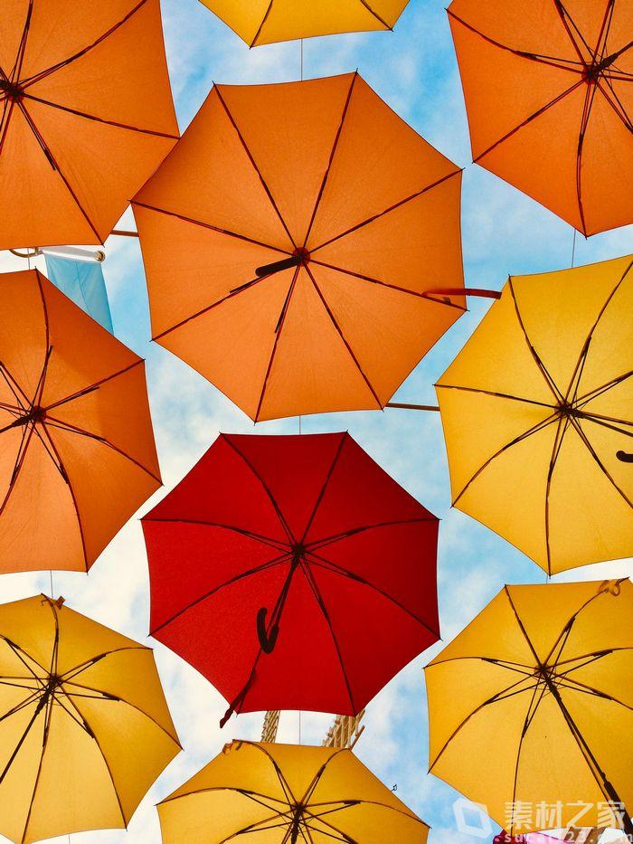 创意橘色雨伞背景高清图